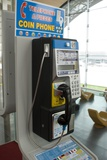 Telephone In Airport Lounge Photographic Print by Mark Williamson
