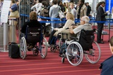 Airline Passengers In Wheelchairs Photographic Print by Mark Williamson