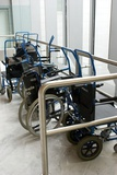 Wheelchairs At Airport Photographic Print by Mark Williamson