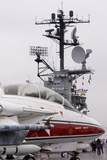 Armed Military Jet on Aircraft Carrier. Photographic Print by Mark Williamson