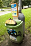 Dog Waste Bin In Prague Photographic Print by Mark Williamson