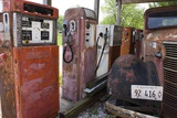 Rusty Gas Pumps And Car Photographic Print by Mark Williamson