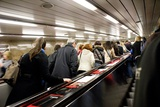 Commuters on Escalators In Prague Metro Prints by Mark Williamson