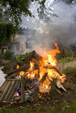 Bonfire In Domestic Garden Photographic Print by Mark Williamson