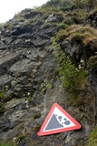 Falling Rocks Warning Sign on Cliffs Photographic Print by Mark Williamson