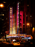 Radio City Music Hall and Yellow Cab by Night, Manhattan, Times Square, NYC, USA, Vintage Colors Photographic Print by Philippe Hugonnard