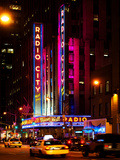 Radio City Music Hall and Yellow Cab by Night, Manhattan, Times Square, New York City, US, USA Photographic Print by Philippe Hugonnard