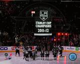 The Los Angeles Kings watch as their 2011-12 Championship Banner is raised Photo