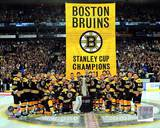 The Boston Bruins raise their 2011 Stanley Cup Chapionship Banner Photo