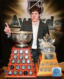 Evgeni Malkin with the Art Ross Trophy and Conn Smythe Trophy Photo