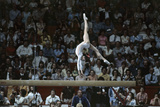 Nadia Comaneci at Montreal Olympic Games Reproduction photographique Premium par Angelo Cozzi