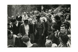 Walter Bonatti and Michel Vaucher Surrounded by Onlookers. Photographic Print