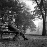 Giuseppe Ungaretti Rests Seated on a Bench in a Park Photographic Print