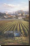 Grapes on Blue Wagon Stretched Canvas Print by A.J. Casson