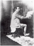 Paul Gauguin (1848-1903) Playing the Harmonium in Mucha's Studio, c.1895 Photographic Print by Alphonse Marie Mucha