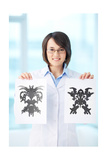 Vertical Portrait Of A Charming Psychologist Showing Two Pictures Of Rorschach Test Poster by  pressmaster