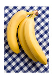 Yellow Bananas On Checkered Tablecloth Poster by  jirkaejc