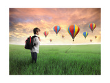 Child Carrying A Backpack Standing On A Green Meadow With Hot-Air Balloons In The Background Posters by  olly2