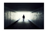 Silhouette Of Man Walking In Tunnel. Light At End Of Tunnel Prints by  Gladkov