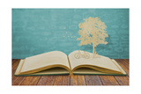 Paper Cut Of Children Read A Book Under Tree On Old Book Poster by  jannoon028