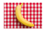 The Yellow Banana On Checkered Tablecloth Posters by  jirkaejc