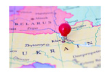 Red Pushpin On Map Of Ukraine Prints by  Bigandt_Photography