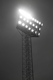 Stadium Spotlights Lit At Night Photographic Print by  gemenacom