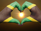Heart And Love Gesture By Hands Colored In Jamaica Flag During Beautiful Sunrise For Tourism Prints by  vepar5