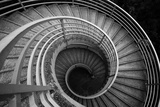 Spiraling Stairs Black And White Poster by  leungchopan