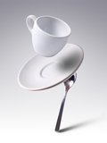 Falling Coffee Cup With Spoon And Saucer Photographic Print by  adnrey