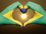 Heart And Love Gesture By Hands Colored In Brazil Flag During Beautiful Sunrise Poster by  vepar5