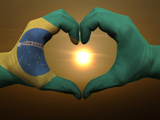 Heart And Love Gesture By Hands Colored In Brazil Flag During Beautiful Sunrise Photographic Print by  vepar5