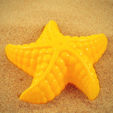 Closeup Of A Yellow Starfish-Shaped Mold On The Sand, With A Retro Effect Prints by  nito