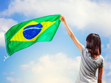 Woman Holding A Brazil Flag Photographic Print by  leungchopan