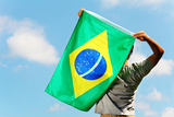 Brazil Supporter Holding A Flag Print by  leungchopan
