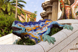 Sculpture Of A Dragon In Park Guell In Barcelona Photographic Print by  Danilin