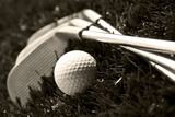 Black And White Photo Of Golf Clubs And A Golf Ball In Low Light For Contrast Photo by  tish1