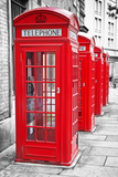 Row Of Iconic London Red Phone Cabins With The Rest Of The Picture In Black And White Poster by  Kamira