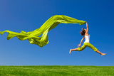 Beautiful Young Woman Jumping On A Green Meadow With A Colored Tissue Photographic Print by  iko