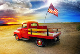 Red Vintage Pick Up Truck With American Flag In Wide Open Country Side With Dramatic Sunset Photo by  curaphotography