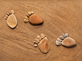 Trace Feet Steps Made Of A Pebble Stone On The Sea Sand Backdrop Photographic Print by  Madlen