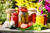 Jars Of Pickled Vegetables In The Garden. Marinated Food Fotografisk tryk af  monticello