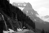 A Black And White Photo Of A Tunnel On The Going-To-The-Sun Road Of A Foggy Valley In Logan Pass Print by  1photo