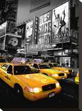 Times Square Taxi Stretched Canvas Print by Dale MacMillan