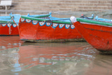 Wooden Boats in Ganges River, Varanasi, India Photographic Print by Ali Kabas