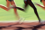 Runners Legs in Motion (Blurred Motion) Photographic Print by Peter Skinner