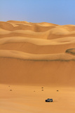 Car in Sand Dunes, Namib-Naukluft National Park, Namibia Photographic Print by David Wall