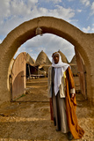 Host Greeting Us to His Mud Brick House in Harran, Turkey Photographic Print by Darrell Gulin