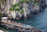 Sun Bathing Dock Along the Sorrento Water Front, Italy Photographic Print by Terry Eggers