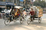 People and Cargo Move Through Streets Via Rickshaw, Varanasi, India Photographic Print by David Noyes